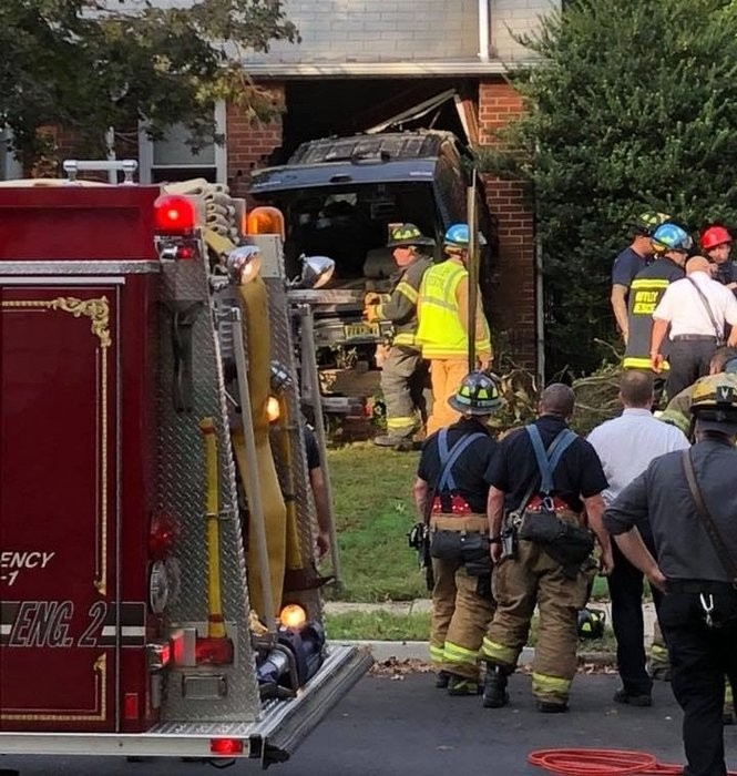 Police and first-responders from several North Jersey towns arrived Tuesday to a Nutley home after an SUV plowed into the structure. (Photo by Kevin Knight | TAPinto Nutley)
