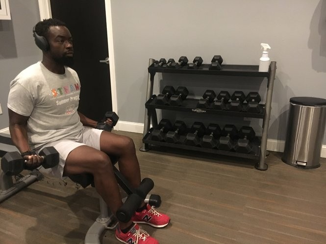 East Orange Councilman Bergson Leneus works out with dumbbells in the gym at his apartment building. He weighed 375 pounds last year, but lost 150 pounds after he was diagnosed with diabetes.