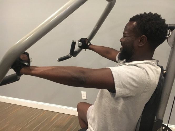 East Orange Councilman Bergson Leneus works out in the gym at his apartment building. He weighed 375 pounds last year, but lost 150 pounds year after he was diagnosed with diabetes