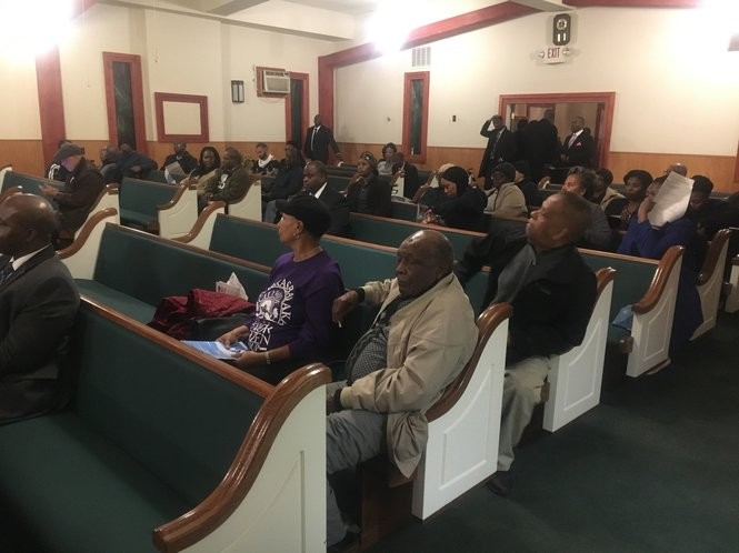 Newark residents attend meeting at Berean Baptist Church to listen to city officials explain what they have done about elevated levels of lead in drinking water.