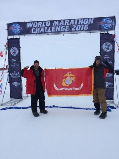 Capts. Daniel Cartica, right), and Cal Ramm in Antartica before the start of the World Marathon Challenge.