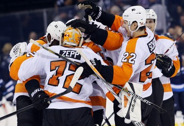 Flyers goalie Rob Zepp (72) celebrates winning his NHL debut on Sunday night. The Flyers rallied from two goals down in the third period for a 4-3 overtime win in Winnipeg. (Bruce Fedyck-USA TODAY Sports)