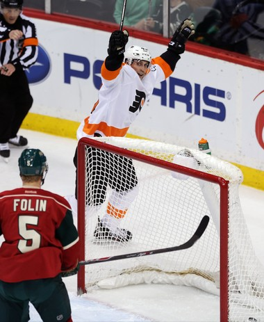Vincent Lecavalier celebrates scoring a goal against the Minnesota Wild on Dec. 23. He has 7 goals and 17 points in 51 games this season playing mostly as a fourth-line right wing. (AP Photo/Jim Mone)