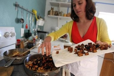 Kate Winslow and Guy Ambrosino, a husband-and-wife food writing and photography team, spent a year in Sicily to work on a cookbook. Here they cook eggplant caponata featured in one of the book.