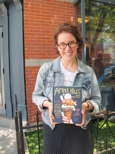 Lauren Kaelin outside the Ample Hills Creamery in Brooklyn with her new book.