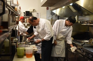 Chef Adolfo Marisi, left, in the kitchen at De Novo.