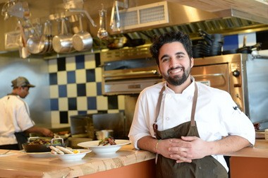 Chef Meny Vaknin at work in his open kitchen at the Mishmish Cafe.