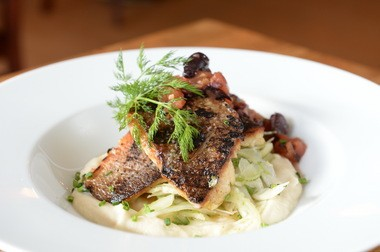 Grilled striped bass is a feature at Mishmish Cafe.
