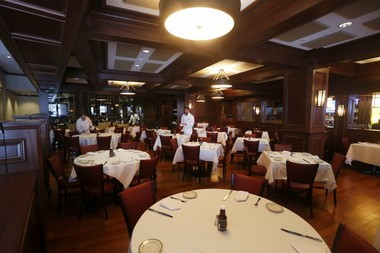 The tasteful dining room at Wolfgang's Steakhouse in Somerville.