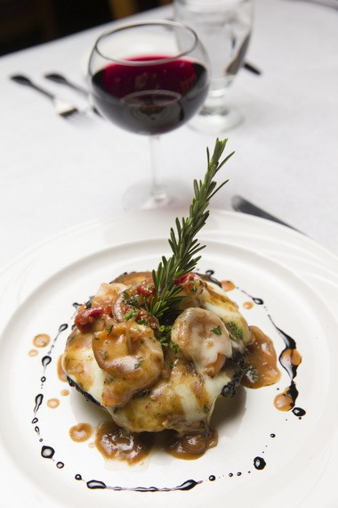 Grilled portobello mushroom and shrimp with melted mozzarella, sun-dried tomato and red onion demi-glace over a bed of polenta.