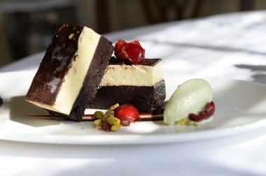 Chocolate nougat torte with a flourless chocolate cake, pistachio ice cream and cherry marmalade.
