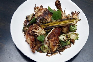 Roasted half chicken with Brussels sprouts, mushrooms and leeks from Turtle + The Wolf.