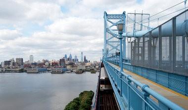 A PATCO train crossing the Benjamin Franklin Bridge.