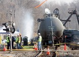 Chemicals are removed from the derailed tank cars in Paulsboro, Monday, Dec. 3, 2012. (Staff Photo by Tim Hawk/South Jersey Times)