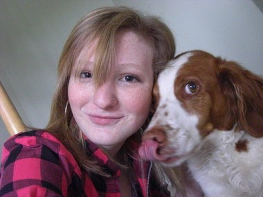 Jessica Smith poses with the Smith family dog Scooter. Scooter, a 12-year-old Britanny Spaniel, was killed after it was caught in a hunting snare in Lock Ave Park in Woolwich Township on February 6. Photo provided
