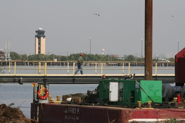 Port 1 L-R Dock builders for AP Construction, Steve Simon and Charles Stifle, take apart the existing BP Pier at the Port of Paulsboro Site. photo by Tim Hawk
