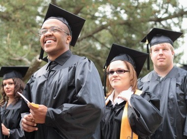 Gordon Andrews of Lawnside, left, who studied business administration at Camden County College, shows his excitement during the commencement ceremony on Saturday, May 18, 2013. (Staff Photo by Jesse Bair/ South Jersey Times)
