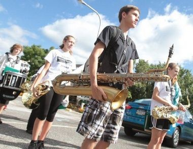 Pitman High School band members, from left, Alex Bierman, Hope Brown, Colin Mahon, and Sophia Falciani line up to march to practice, Saturday, Sept. 14, 2013. (Staff Photo by Britney Lillya/South Jersey Times)