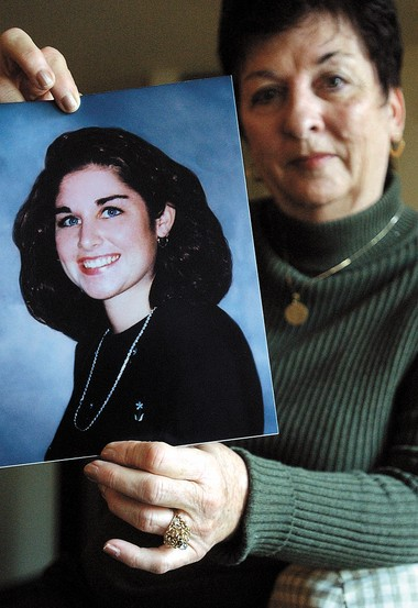Carole McDonnell, of Washington Township, holds a picture of her daughter Maggie in a photo that was taken 3 days before she was killed by a driver that fell asleep behind the wheel in this 2002 file photo.