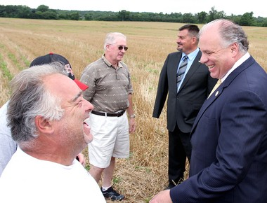 Senate President Stephen Sweeney, right, shares a laugh with Jim Valentine, of Woolwich Township, left, after a press conference about the recent preservation of this 83-acre farm on Russell Mill Road in Woolwich Township that was slated to become a housing development, Tuesday, July 29, 2014. (Staff Photo by Lori M. Nichols/South Jersey Times)