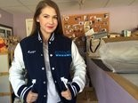 Katelyn Darrow of Pitman in a one-of-a-kind jacket she received from the Steve Harvey Show, which honored her for her work with the Angels of God Clothing Closet, Oct. 6, 2014.