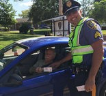 A Pitman police officer thanks a motorist for safe driving, Wednesday, Aug. 12, 2015 (photo courtesy of Pitman Police Department)