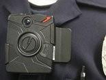 A close-up of a police body camera.