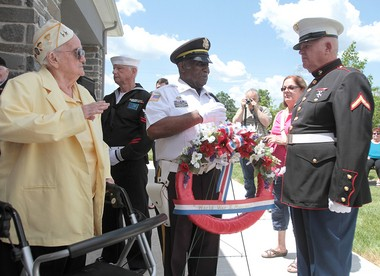 World War II Army nurse Dot Kennedy, and Honor Guard Captain George Brown present a wreath to Private First Class Bill Hughes during a Memorial Day Ceremony at the Gloucester County Veterans Memorial Cemetery, in Monroe Township, Sunday, May 25, 2014. (Joe Warner/South Jersey Times)