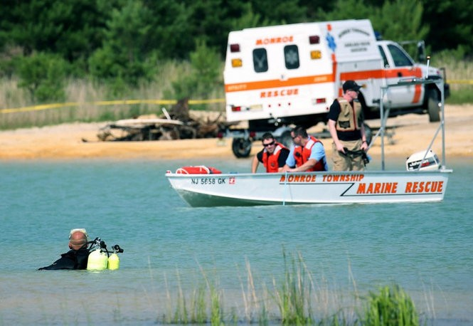 Rescuers search for Darius Boyer after he went missing while swimming with friends at the Jackson Road Blue Hole quarry in Monroe Township in July 2015. (Lori M. Nichols | For NJ.com)