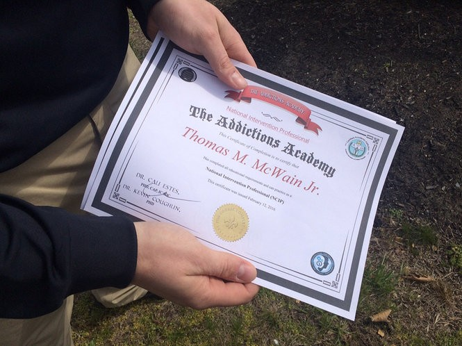 Officer Thomas M. McWain holds the certificate he received for completing addiction recovery coach training. He was featured in a 2016 New Jersey Advance Media story. (File photo)