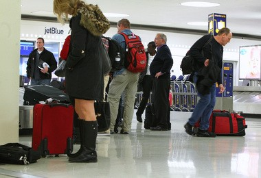 Dentists in New Jersey are asking their patients whether they have traveled to Liberia, Sierra Leone or Guinea in the last 21 days to see if they could be infected with Ebola. In this file photo passengers go through Newark Liberty International Airport on Oct. 24, the day the state quarantined nurse Kaci Hickox.