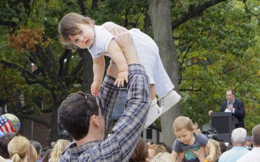 Benjamin Hiscock of Ewing is held high above the crowd by his dad Michael Hiscock as they take part in a rally in front of the State House opposing new vaccine mandates by the state for children, in this 2008 file photo. (Tony Kurdzuk|The Star-Ledger)
