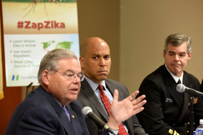 U.S. Senators Bob Menedez and Cory Booker with Dr. Stephen Redd, CDC Director of the Office of Public Health, Preparedness and Response, lead a statewide summit focused on NJ's preparedness for preventing spread of Zika virus. (The Associated Press)