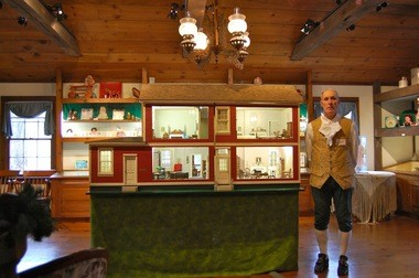 Cranbury Museum docent Don Davidson next to the Bunting Doll House, which will be on exhibit Sundays through April 14.