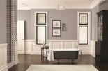 A calm gray bathroom has Sherwin-Williams paint (SW7080) on the walls with a black and white color scheme and dark wood floors.