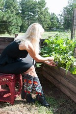 Growing in a raised bed makes it possible to sit and garden in a dress and fancy boots.