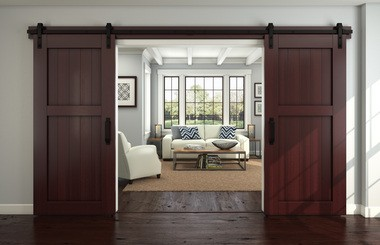 Two hardware kits from National Hardware make it possible to hang barn-style doors in double.