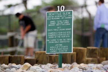 """A sign dedicating the 10th hole on the """"Green"""" course to the Triple Crown-winning race horse Seattle Slew at the new mini golf course at Monmouth Park."""