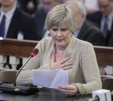 "Claudia Burzichelli , 54, becomes emotional as she addresses the Health and Senior Services Committee during a February meeting considering the controversial bill ""Death with Dignity Act"". Burzichelli, a cancer survivor, supports the bill being debated in the Assembly. The bill would grant doctors the right to prescribe lethal doses of drugs to patients who have less than six months to live."
