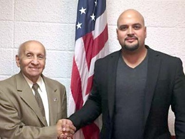 Omar Salgado, right, candidate for Hudson County register, with his grandfather, the Rev. Fernando Colon, a former Hudson County freeholder and Jersey City councilman.