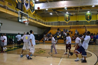 """Teams competing at the """"Shoot Hoops Not Guns"""" basketball tournament that was organized by Assemblyman Charles Mainor and was held earlier this afternoon at the John J. Moore. athletic center in New Jersey City University."""