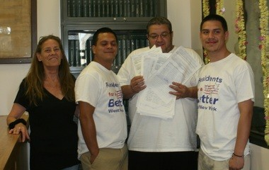 Frank Ferriera, second from right, and other Residents for a Better West New York members file petition for referendum on switching to an elected school board