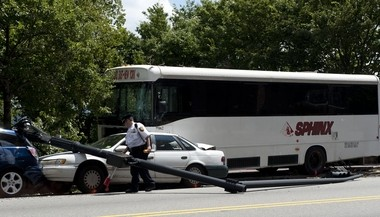 An officer works on the scene of a bus accident on Boulevard East near 56th Street in West New York on July 30.