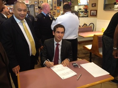 Jersey City City Councilman at large Rolando Lavarro and Mayor Steve Fulop at Helen's Pizza today, where Fulop signed the city's paid sick time bill into law.