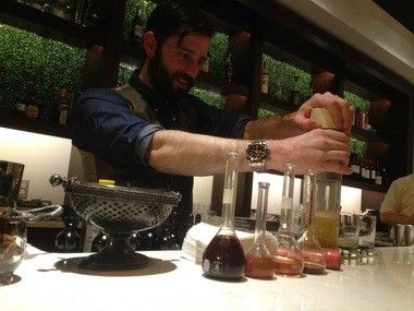 Mixologist Noah Sexton carbonates some scotch behind the bar at Union Republic. Wednesday, Jan. 21, 2015.
