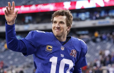 New York Giants quarterback and Hoboken resident Eli Manning (10) smiles as he runs off the field in the second half as the Giants defeat the Redskins, 24-13, in NFL Week 15 action at Met Life Stadium on December 14, 2014. Manning's Hoboken condo is currently on the market.
