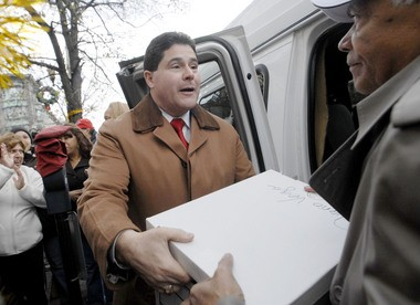 Felix Roque helps unload boxes of completed recall election signatures on Monday, December 7, 2009. Dylan Wilson | The Jersey Journal