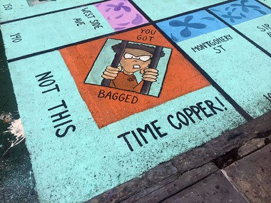 A square on the Jersey City Monopoly board on the Newark Avenue pedestrian plaza is stirring debate over the depiction of the prisoner behind bars.