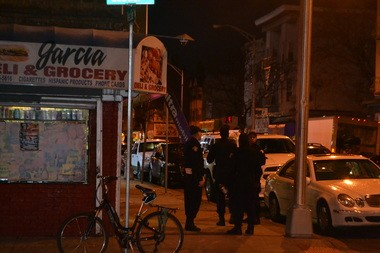 Officers patrol West Side Avenue the night after two cops were assaulted. Caitlin Mota | The Jersey Journal