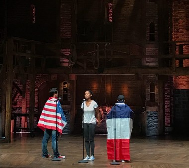 Weehawken High School juniors, from left, Jose Mesa, Devynn Givens, and Chris Arias perform their original skit at the Richard Rodgers Theatre in Manhattan.